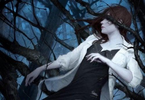 ağaçta kadın resmi