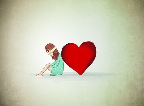 kalp yanında gözü bağlı oturan kız