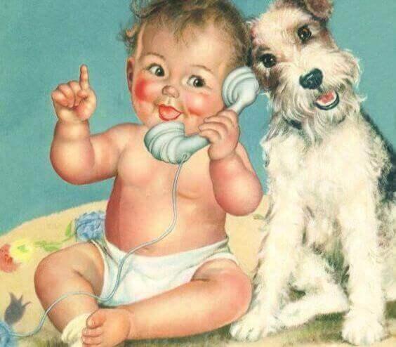 telefonda bebek ve yanında köpek