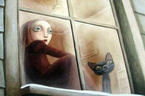 pencereden bakan kız ve kedi