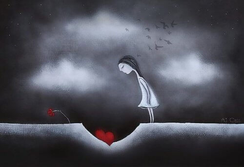 yerdeki kalbe bakan kadın