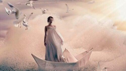 kağıttan teknede kadın ve uçan kuşlar