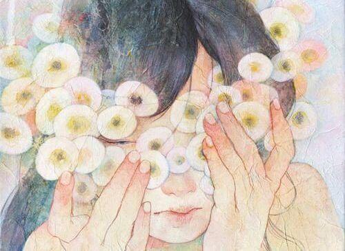 depresyonda yüzünü kapatan kadın