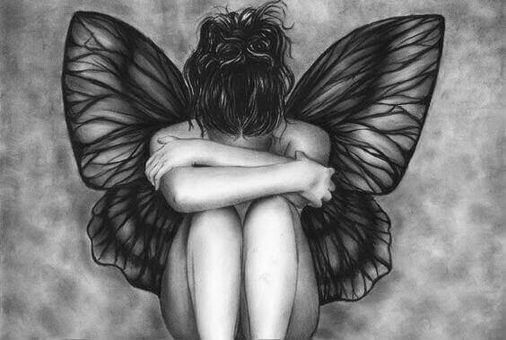 melek kanatlı üzgün kadın