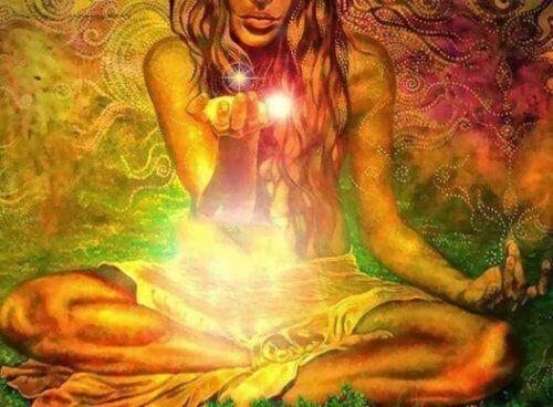 elinde ışık tutan kadın
