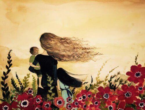 çiçek tarlasında rüzgarda duran aile