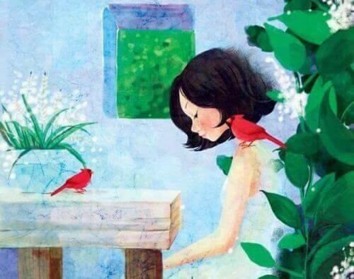 bahçede oturan kız ve kuş