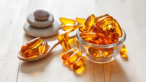 vitamin kapsülleri ve üç taş