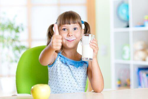child consuming whole milk products