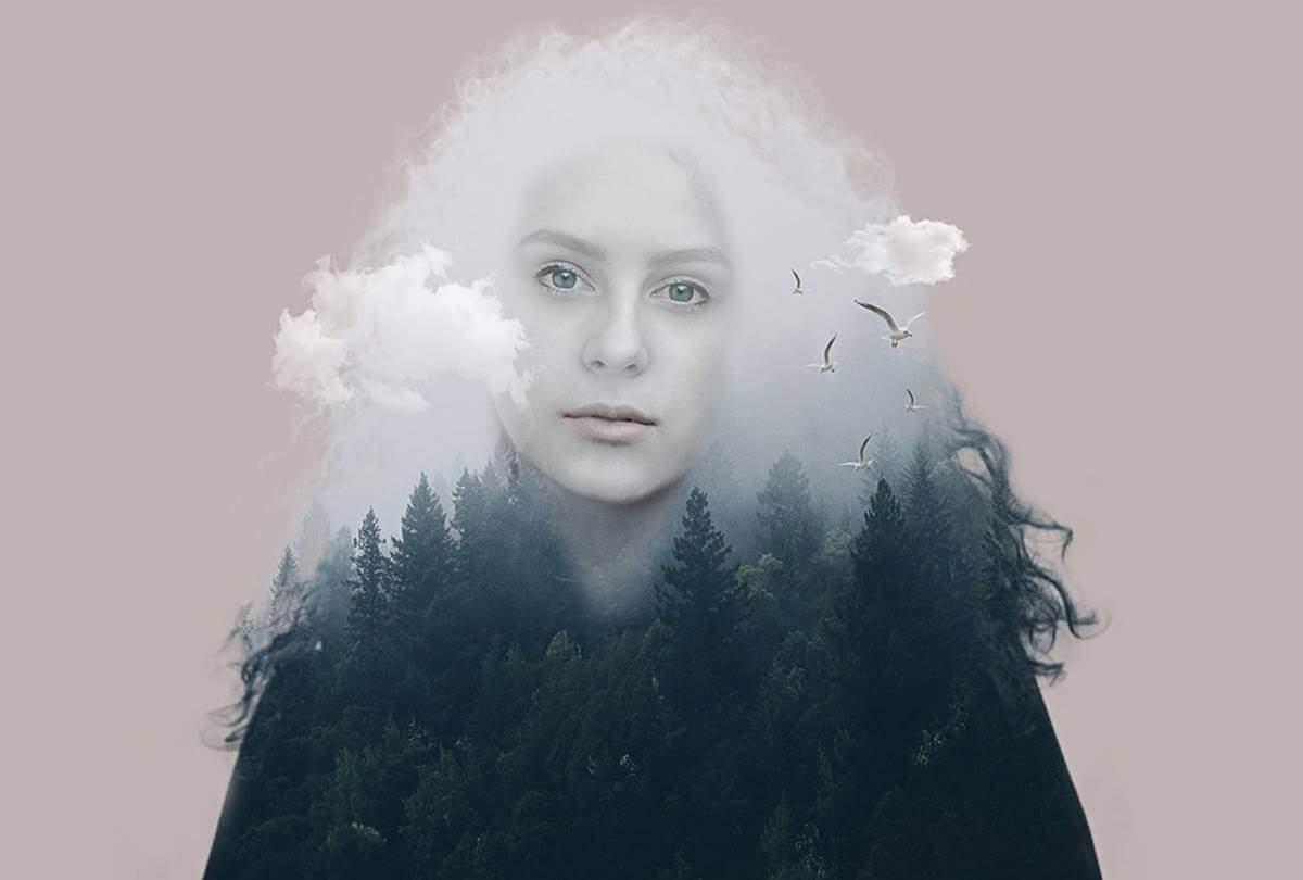 bulutlar ve ormanla sarılı bir kadın